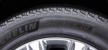 A Michelin brand tire showing the tire load, index and speed numbers.